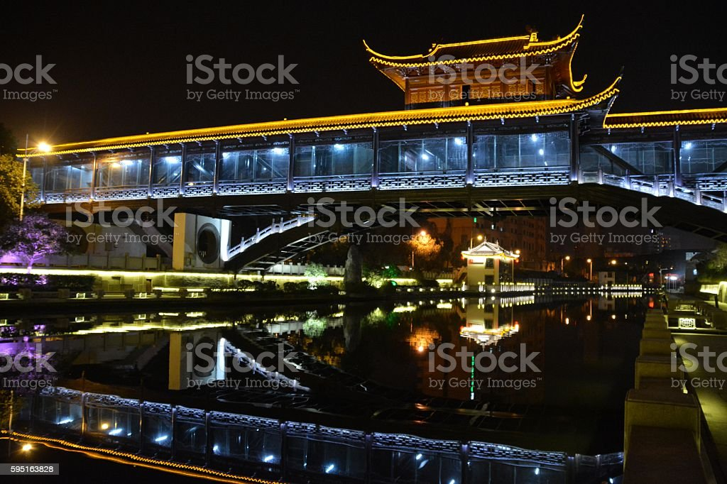 Bridge reflecting on canal in Wuxi, Jiangsu province, China stock photo