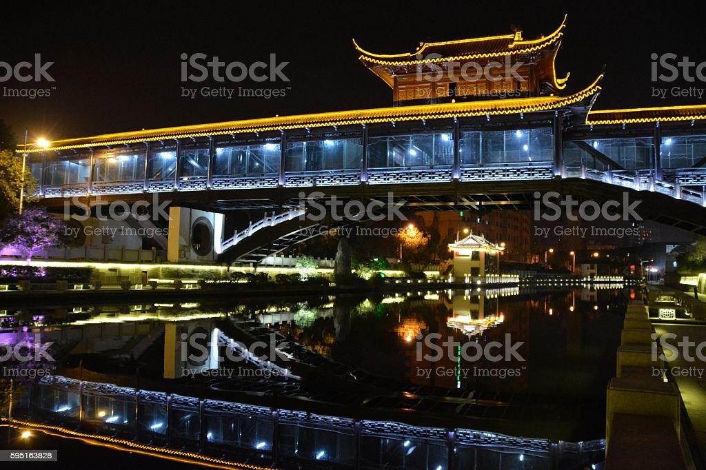 Bridge reflecting on canal in Wuxi, Jiangsu province, China stock photo