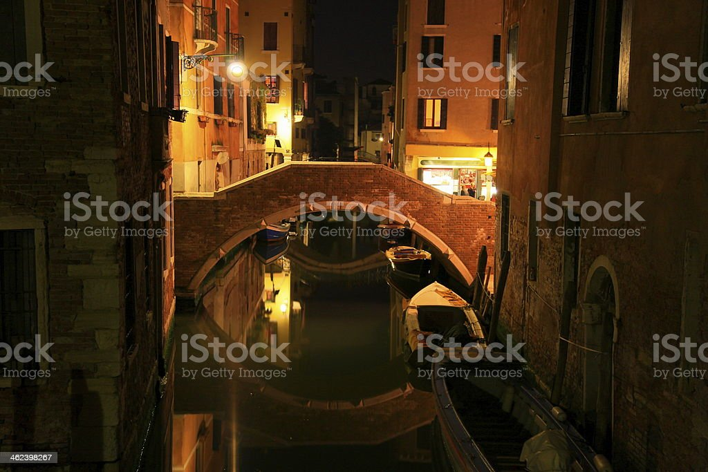 Bridge reflection & corner in Venice at night, Italy royalty-free stock photo