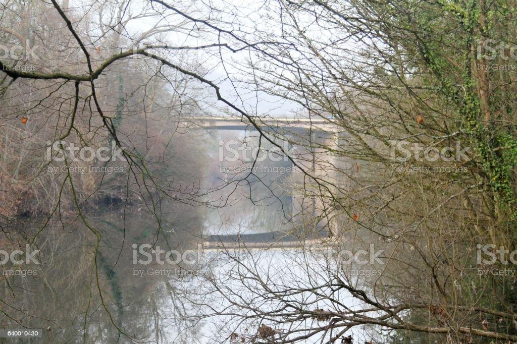 Bridge reflection in river stock photo