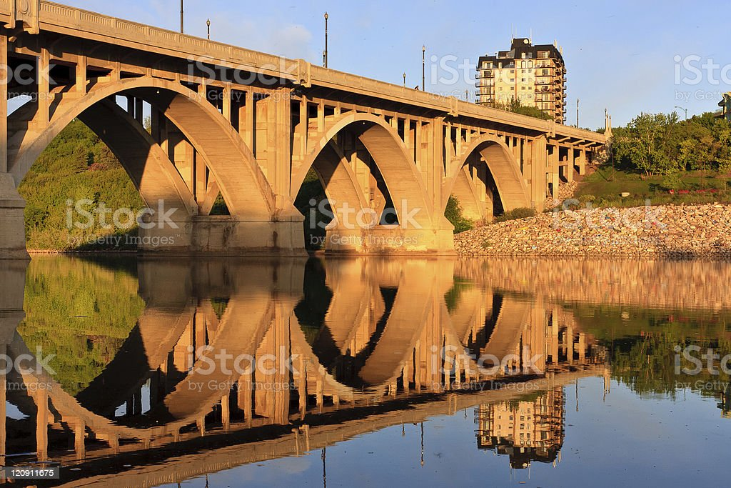 Bridge relecting in calm River royalty-free stock photo