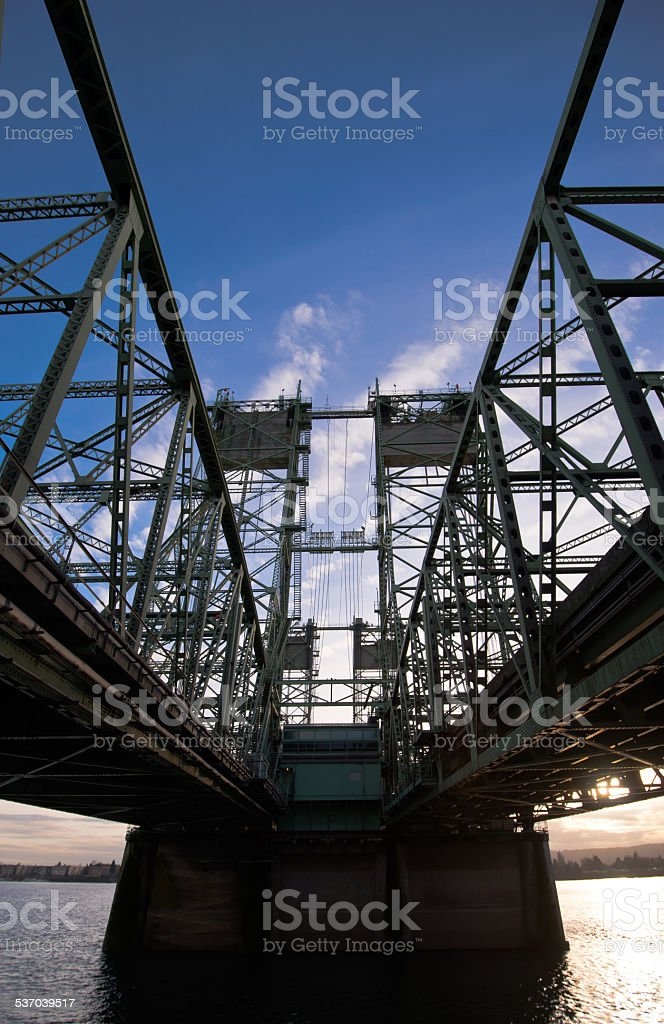 Bridge steel trusses lifting towers on concrete support stock photo
