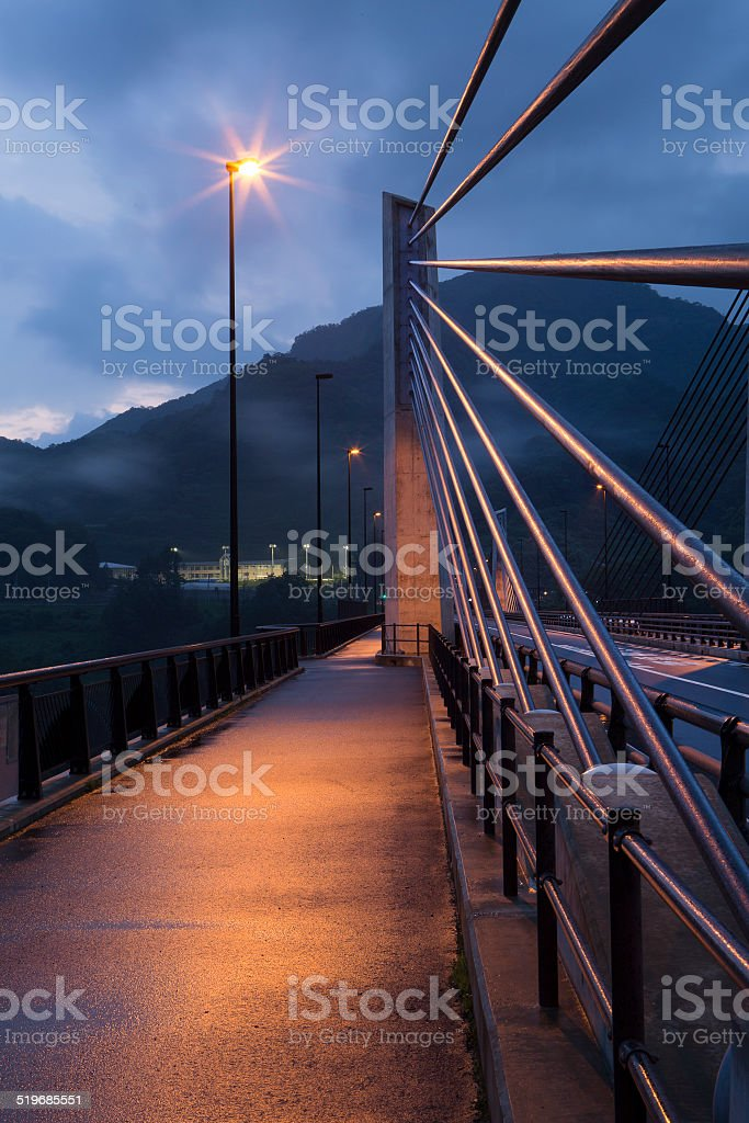 Bridge supports illuminated by a street light stock photo
