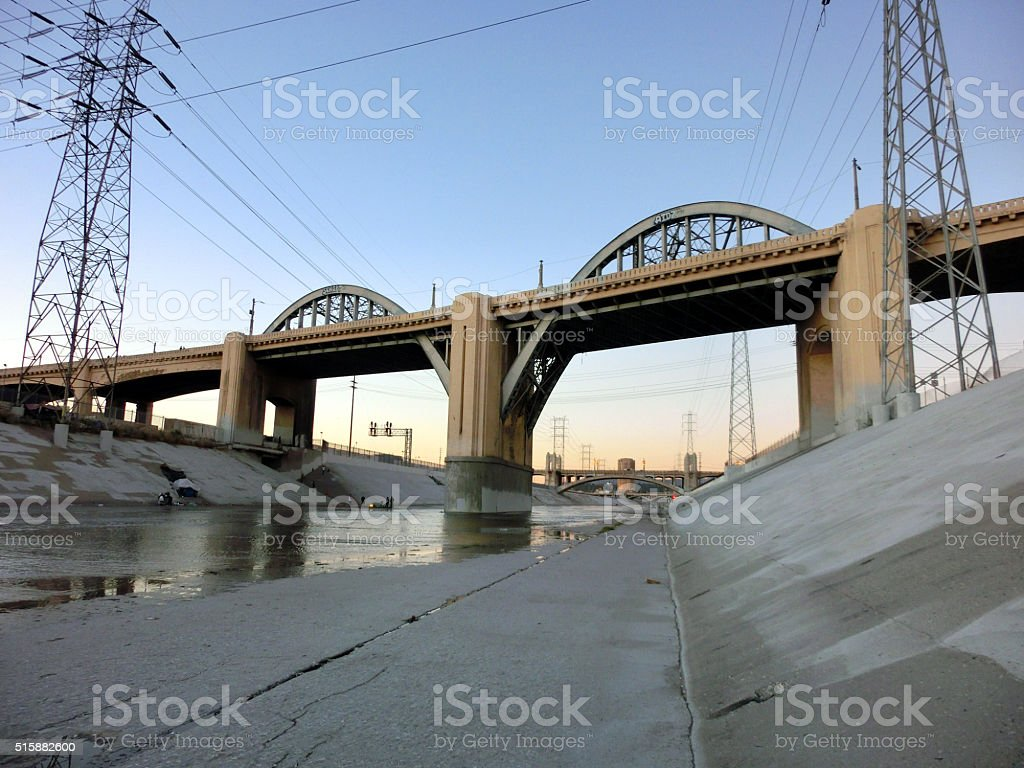 Bridge view from Los Angeles river canal at dusk stock photo