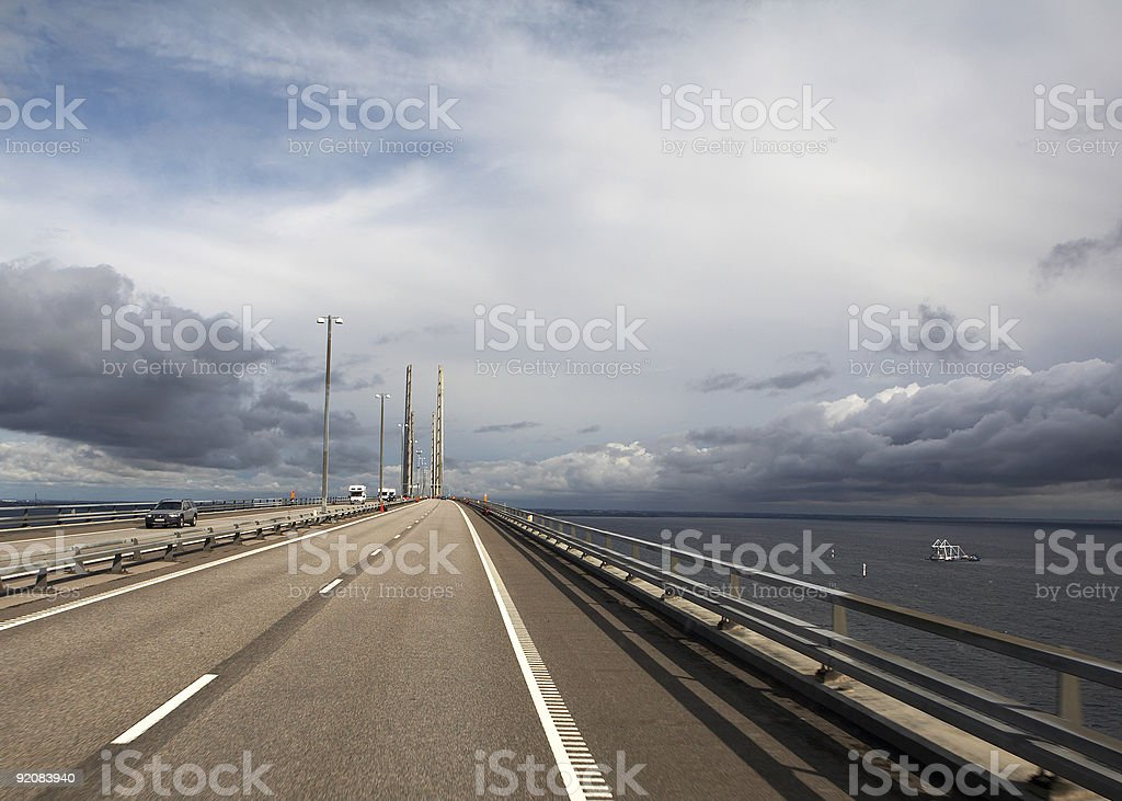 Bridge whit black clouds and blue sky royalty-free stock photo