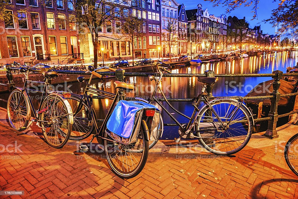 Bridge with Bicycle and Water Channel in Amsterdam at Night stock photo