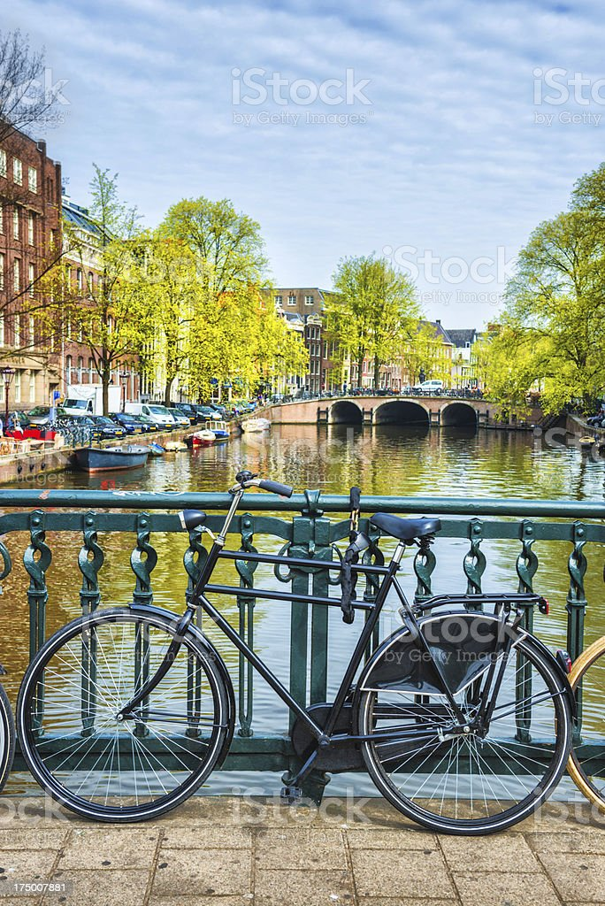 Bridge with Bicycle and Water Channel in Amsterdam stock photo