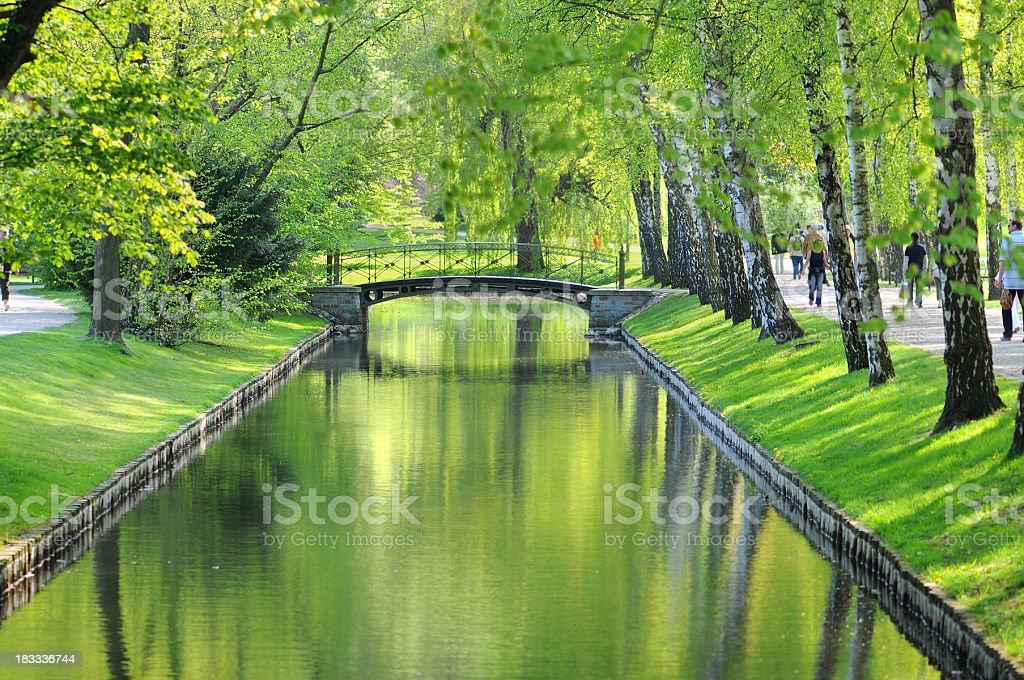 bridge with water Canal at park in Schwerin (Germany) stock photo