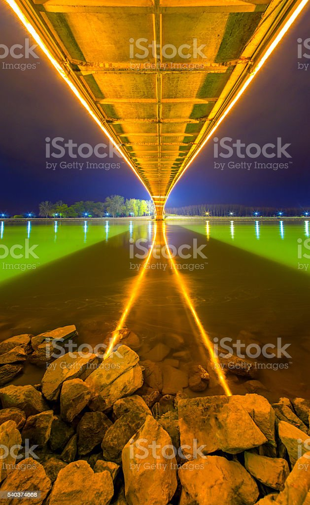 Bridge with yellow lights and reflection in the river stock photo