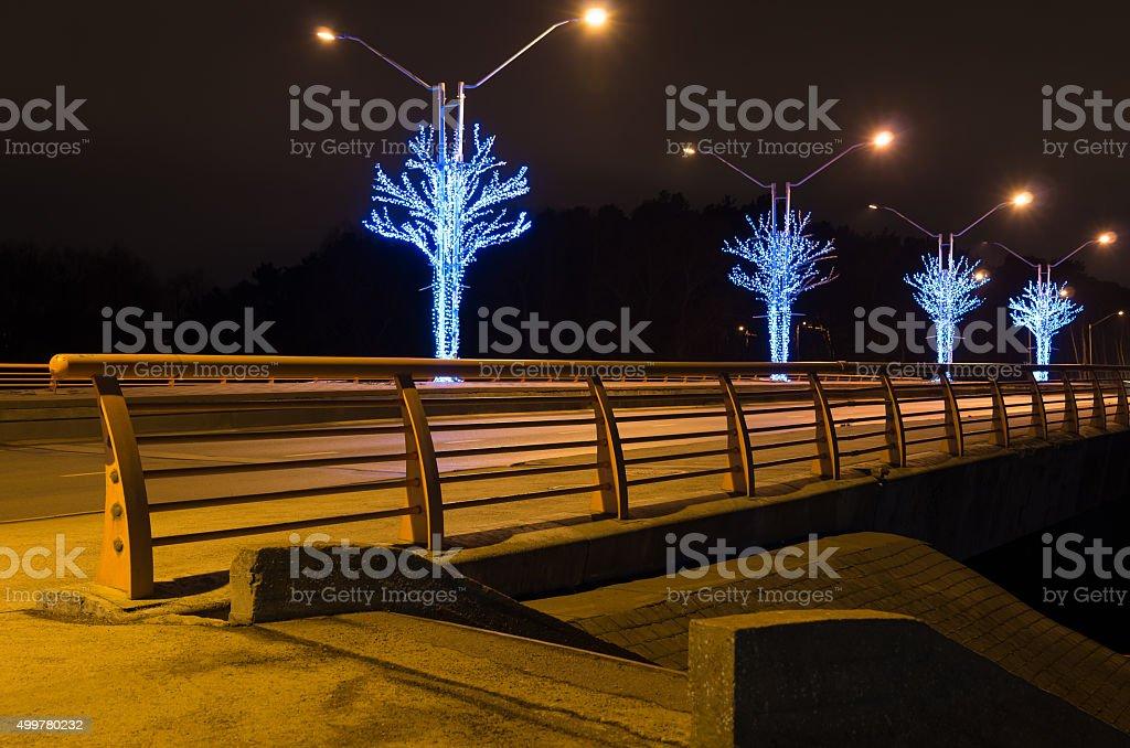 bridge with yellow rail at night stock photo