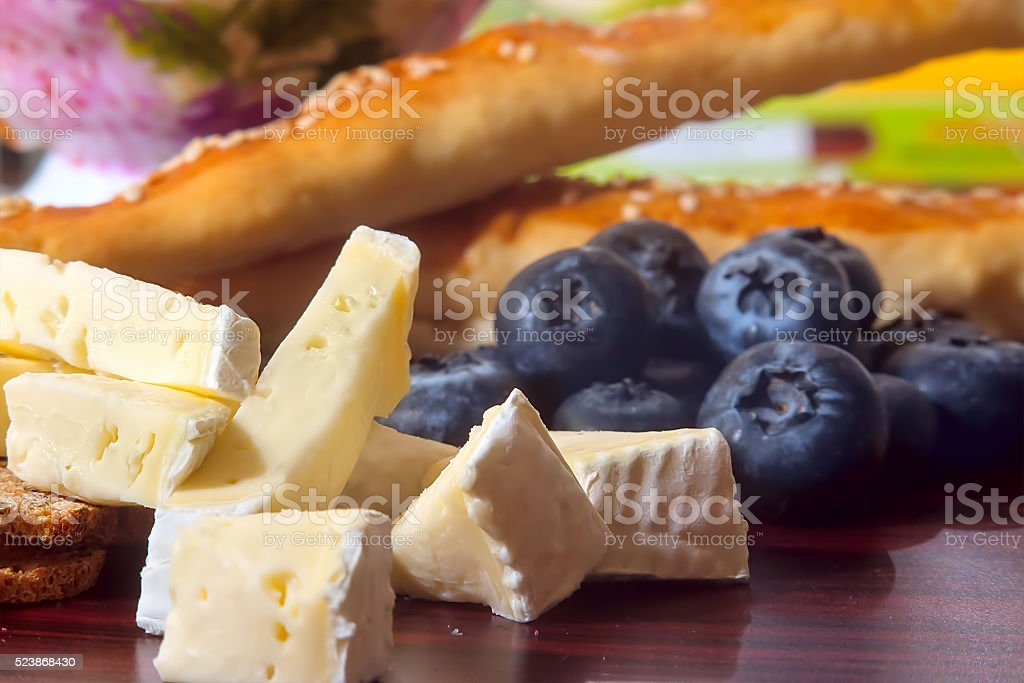 brie and berries stock photo