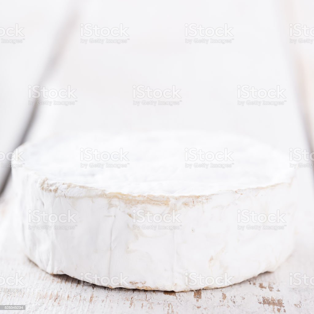 Brie cheese on a wooden Board stock photo