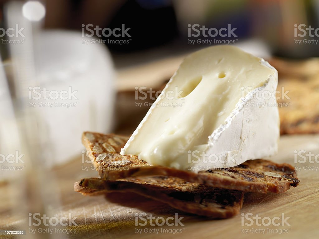 Brie Cheese on Crackers with Wine royalty-free stock photo