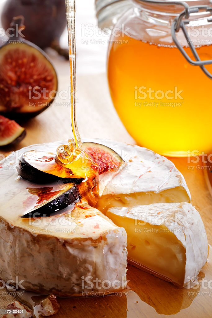 Brie Cheese with Figs and honey stock photo