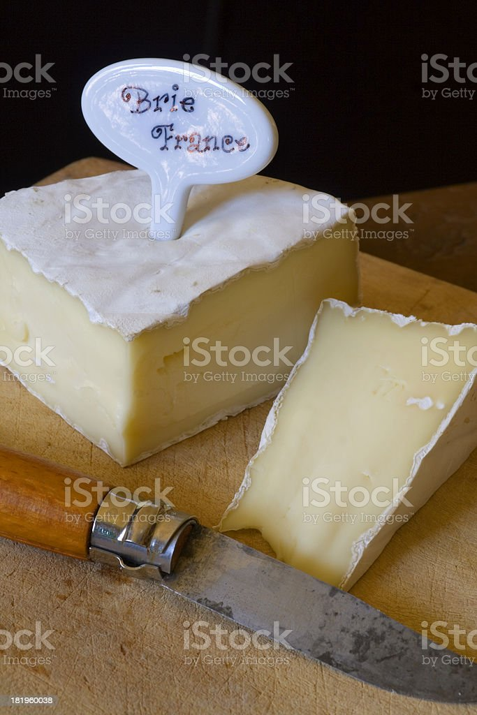 Brie & Knife with Label Vt royalty-free stock photo
