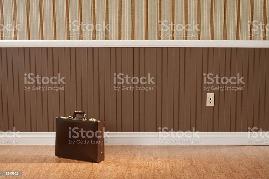 Brief Case In Empty Room royalty-free stock photo
