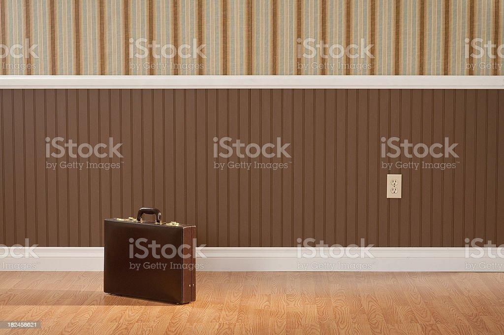 Brief Case In Empty Room stock photo