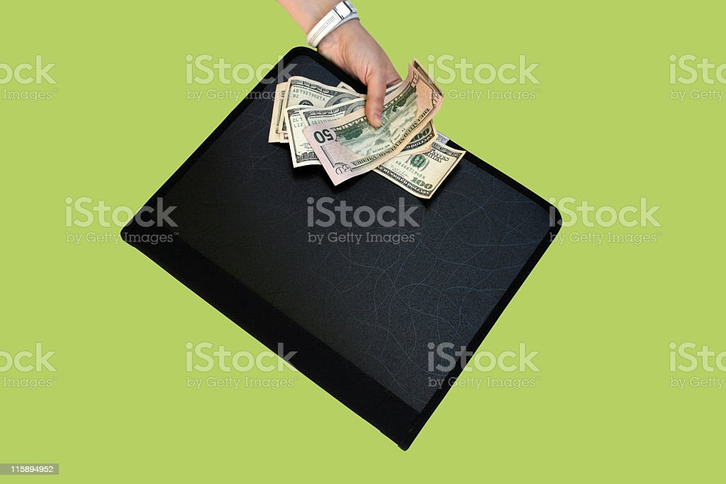 Briefcase and dollars stock photo