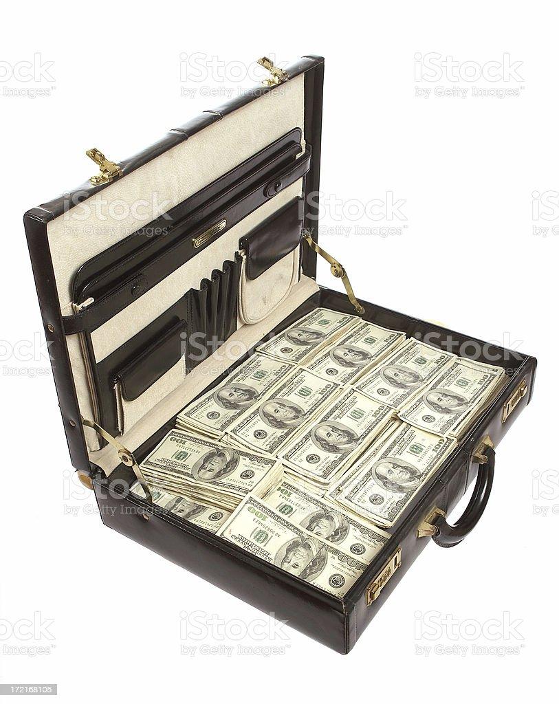 Briefcase full of money stock photo