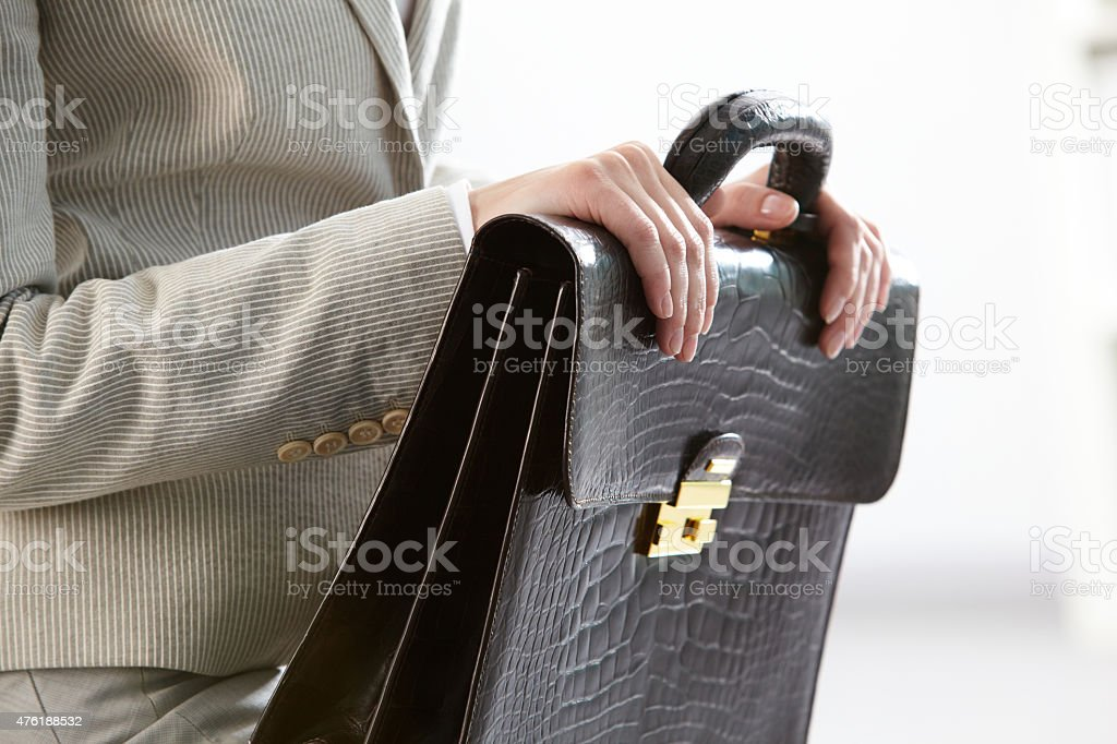 Briefcase in hands stock photo