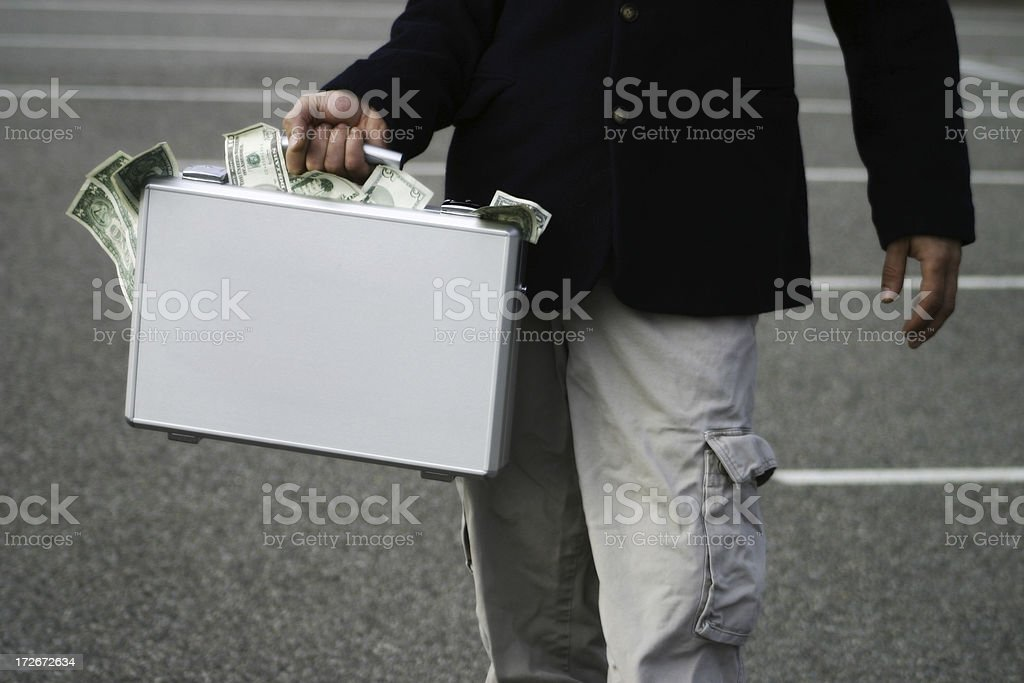 Briefcase of cash stock photo