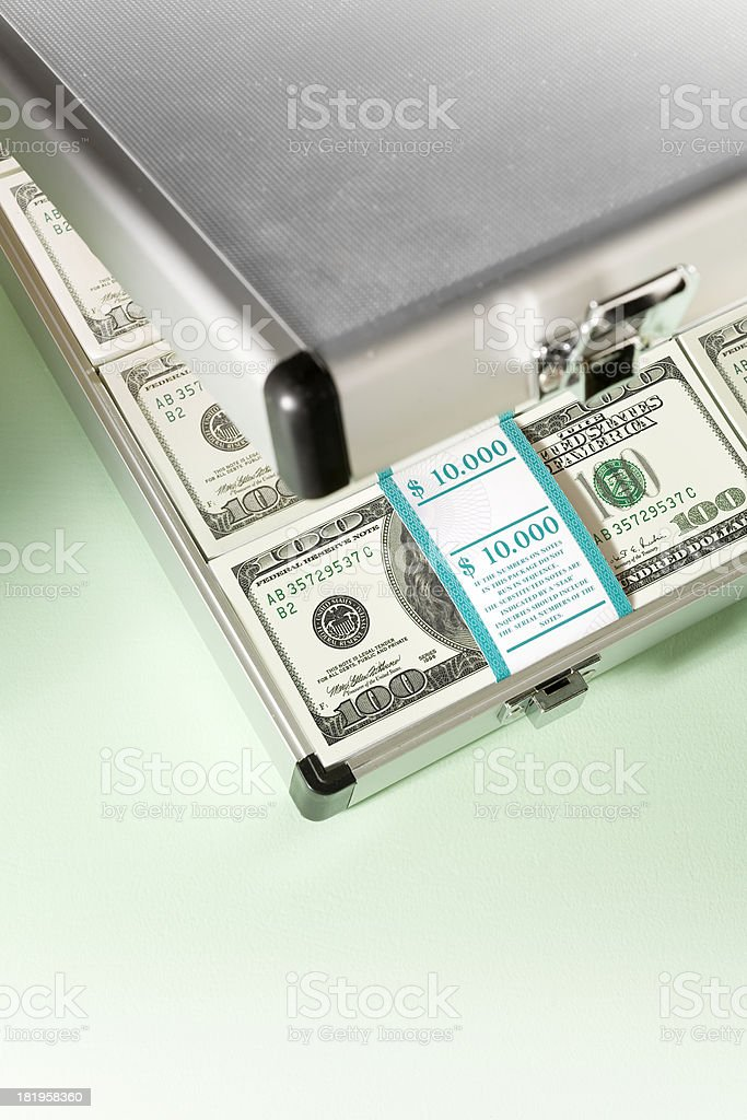 Briefcase with bundles of 100 Dollar bills royalty-free stock photo