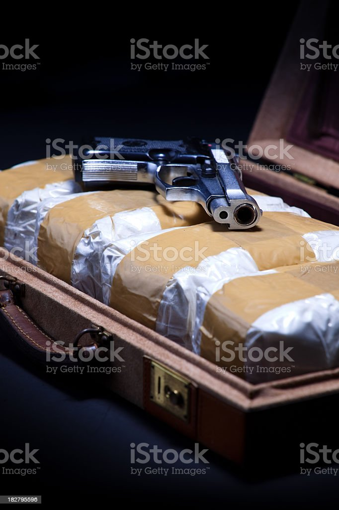 Briefcase with Cocaine and a Handgun royalty-free stock photo