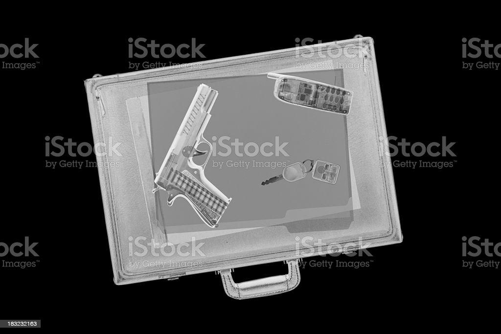 Briefcase with Gun stock photo