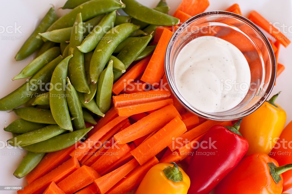 Bright and colorful veggie platter with ranch dip stock photo