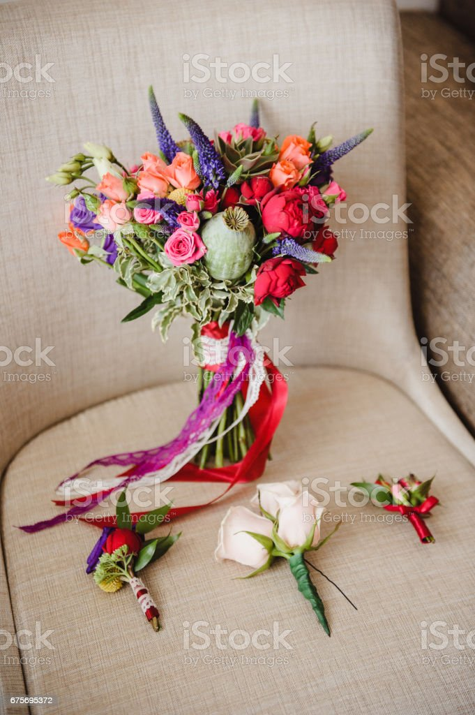 Bright and stylish bouquet of the bride. Wedding floristics and details. stock photo