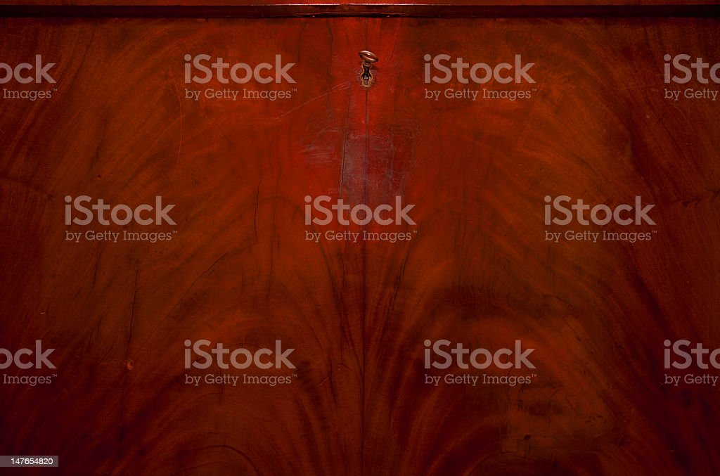 Bright and warm wood bureau with a key stock photo