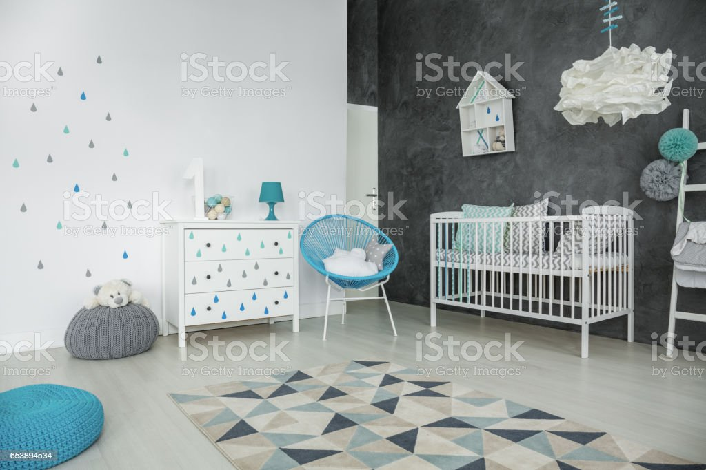 Bright baby bedroom with cot stock photo