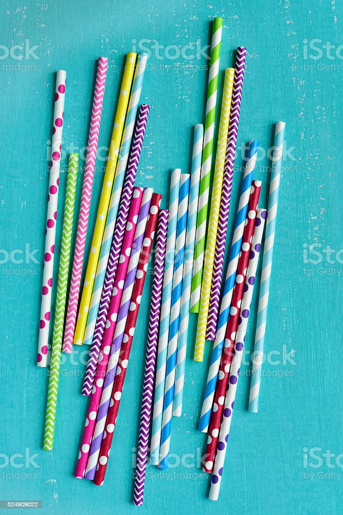 Bright background of colorful paper straws . stock photo