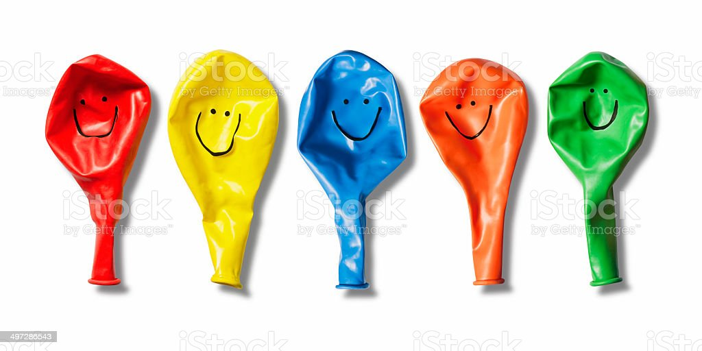 Bright balloons with hand drawn happy smiley faces royalty-free stock photo
