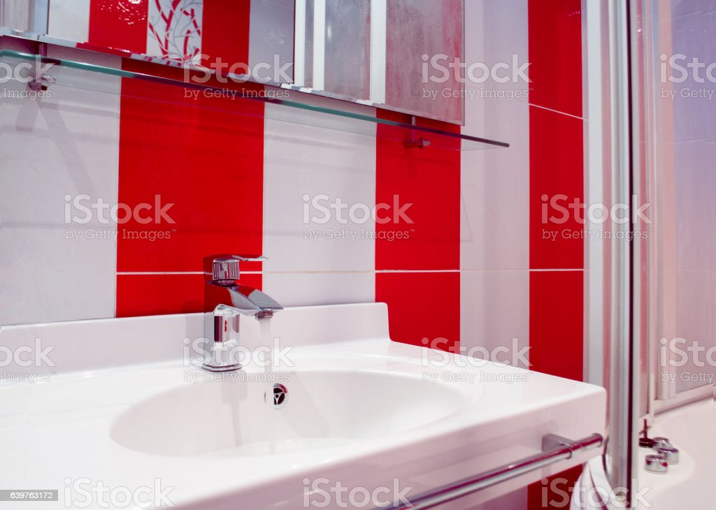 Bright bathroom interior in red and white colors stock photo