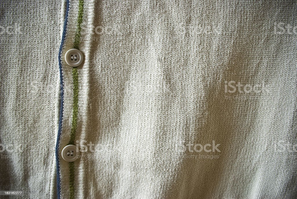 Bright beige or white cardigan sweater with buttons royalty-free stock photo