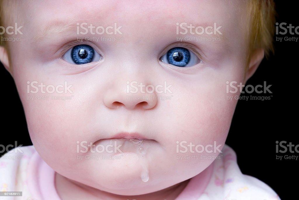 Bright Blue Eyes - Teething Baby stock photo