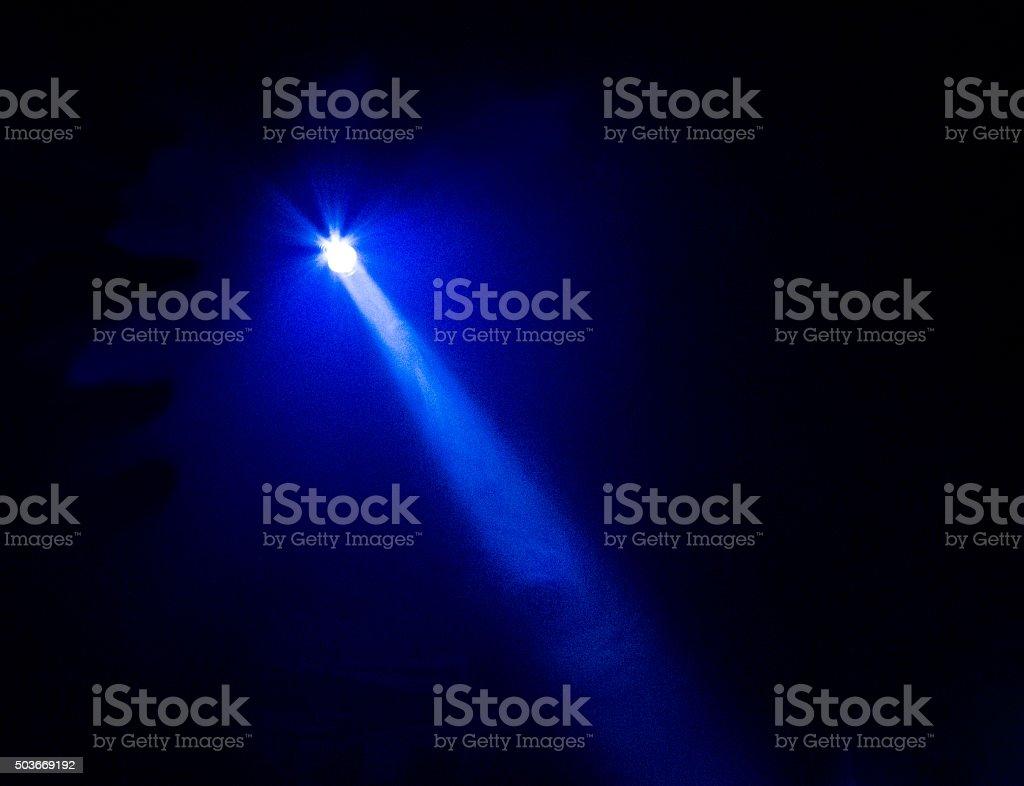 Bright Blue Flashlight Beam stock photo