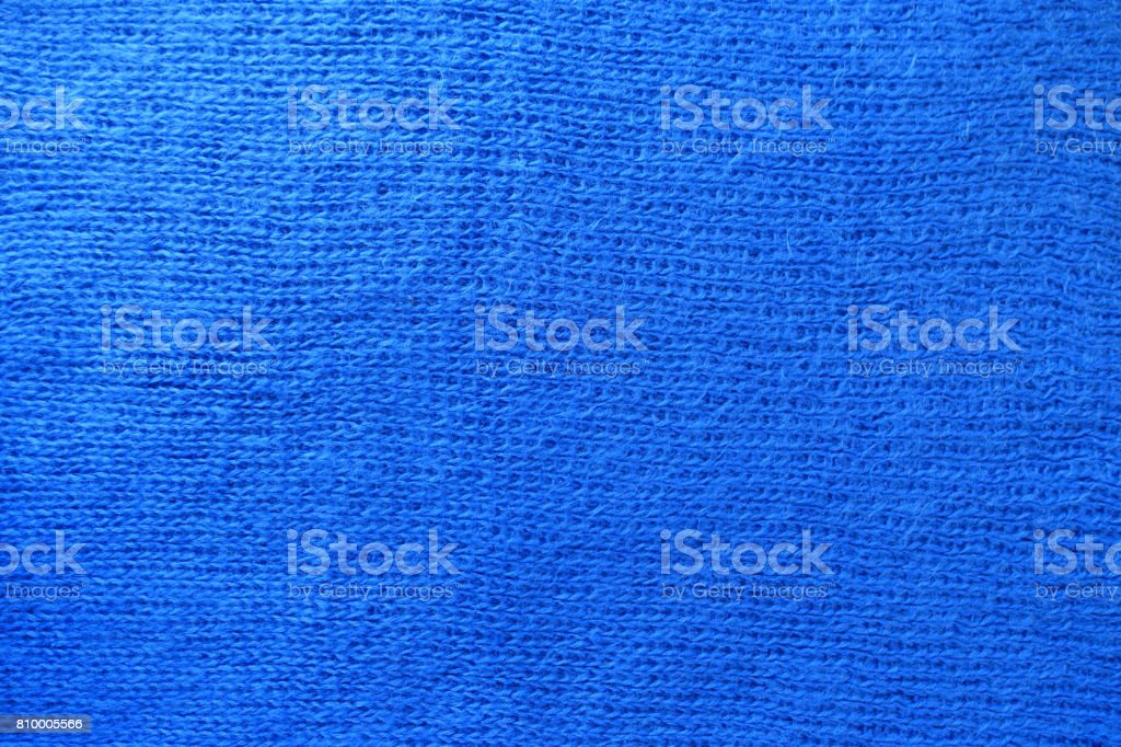 Bright blue handmade stockinette fabric fron above stock photo