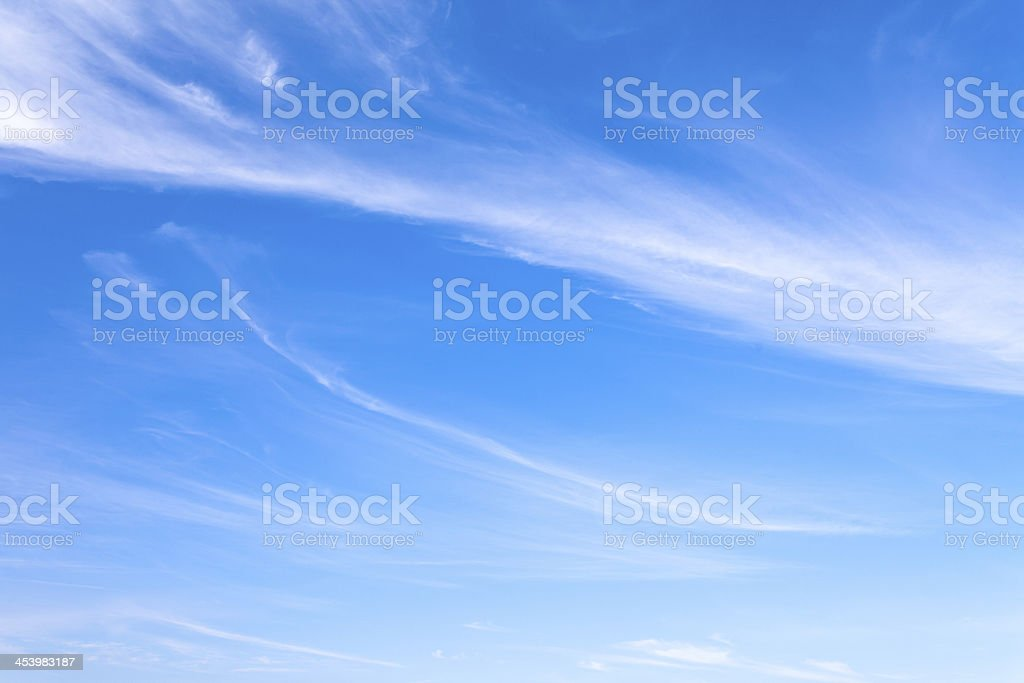 Bright blue sky with white wispy clouds royalty-free stock photo