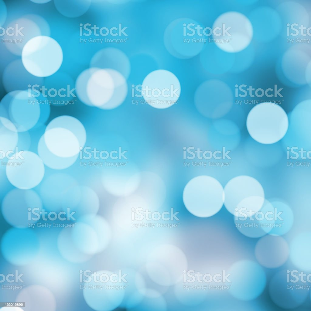 Bright blurred bokeh dots on light color background stock photo