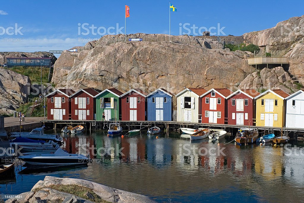 Bright boat-houses in small fishing viliage royalty-free stock photo