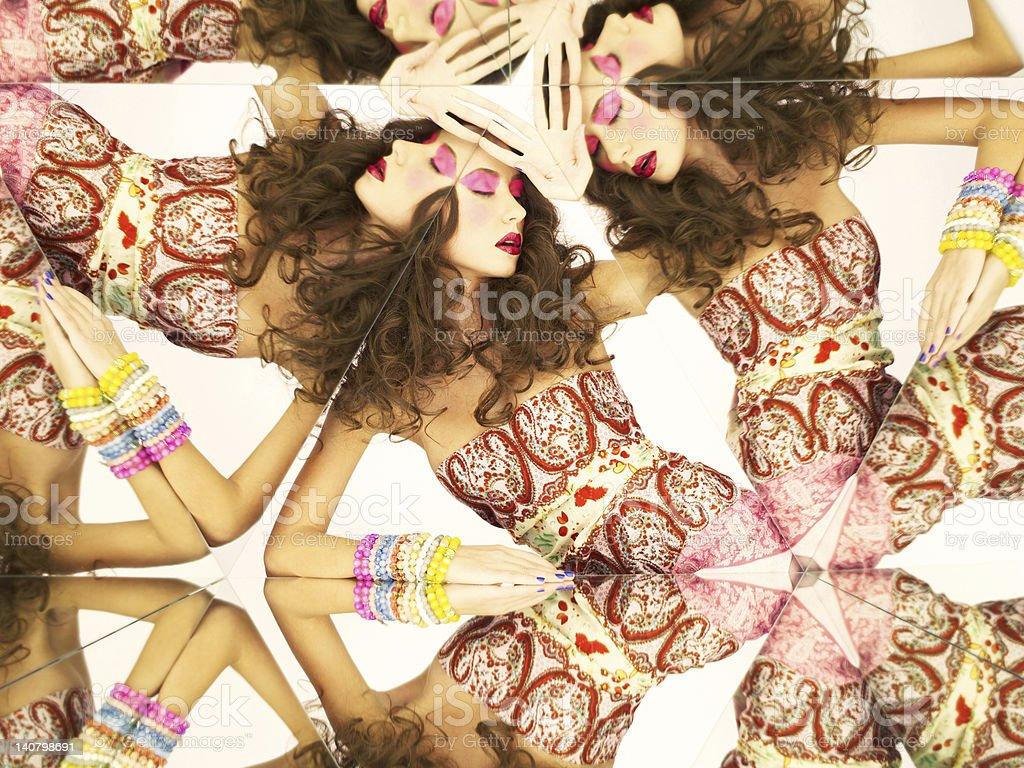 Bright brunette in kaleidoscope stock photo