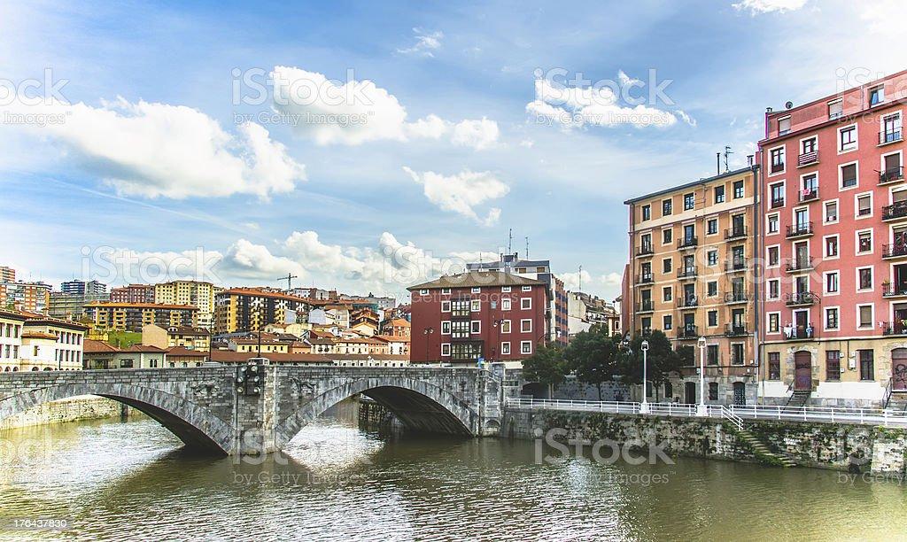Bright buildings in Bilbao Spain overlooking a bridge stock photo