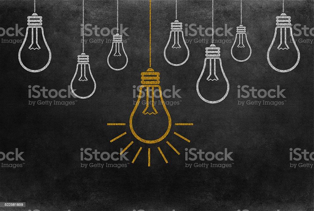 Bright Bulb Idea on Blackboard stock photo