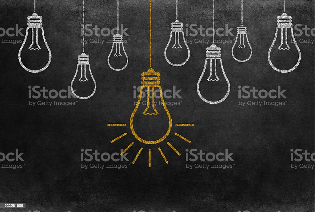 Bright Bulb Idea on Blackboard stock photo