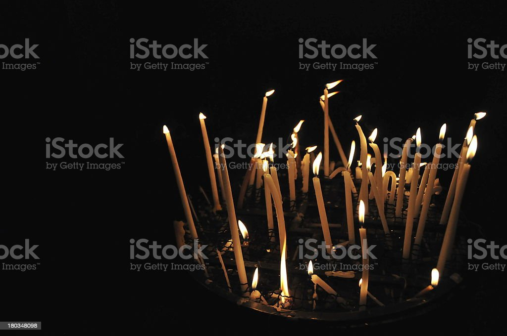 Bright burning candles, black copy space, Jerusalem, Holy Sepulcher church stock photo