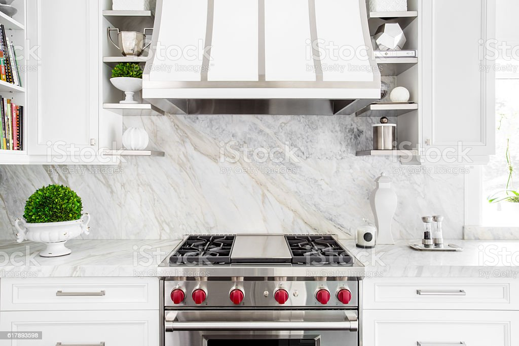 Bright Classic White kitchen with gas range stock photo