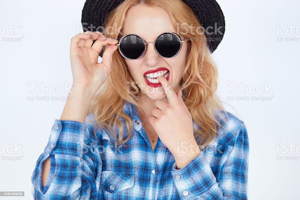 bright closeup portrait picture of funny teenage girl in shades stock photo