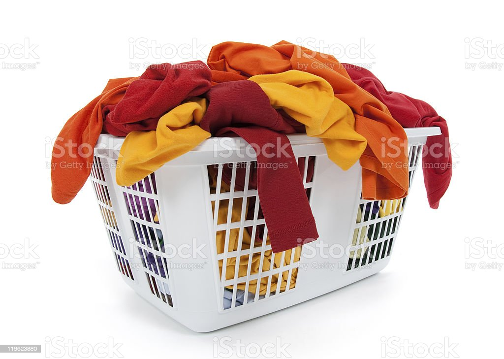 Bright clothes in laundry basket. Red, orange, yellow. royalty-free stock photo